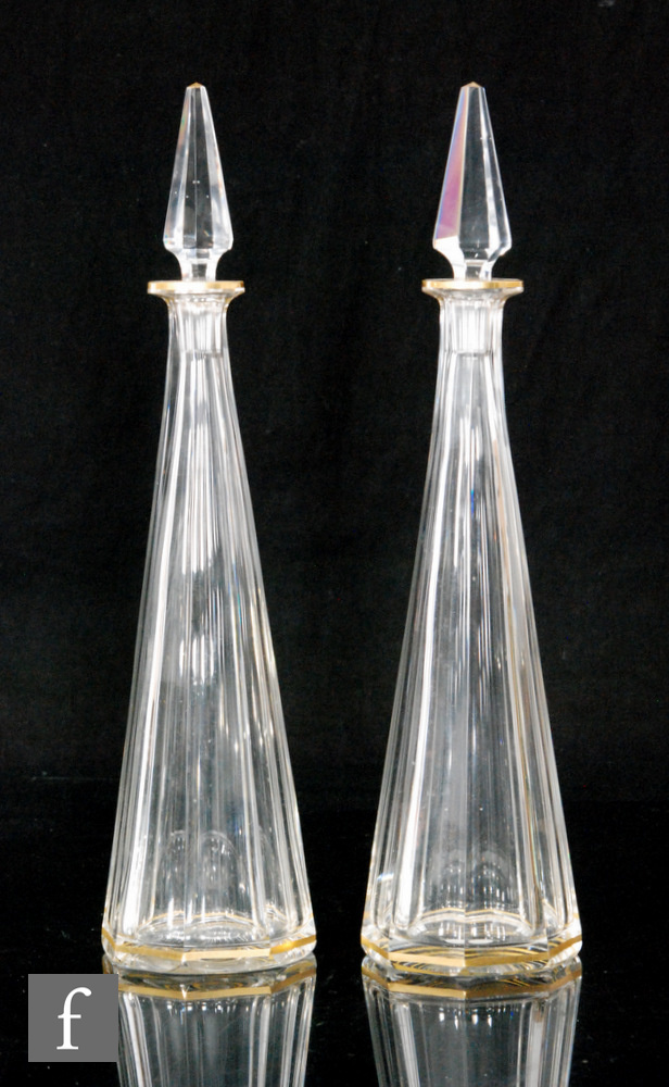 A pair of late 19th Century clear crystal spirit decanters by Baccarat, of slender tapered form with