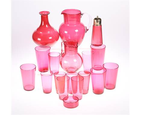 A COLLECTION OF VICTORIAN CRANBERRY GLASS, comprising two pitchers, carafe, thirteen tumblers, salt and sifter. (18)