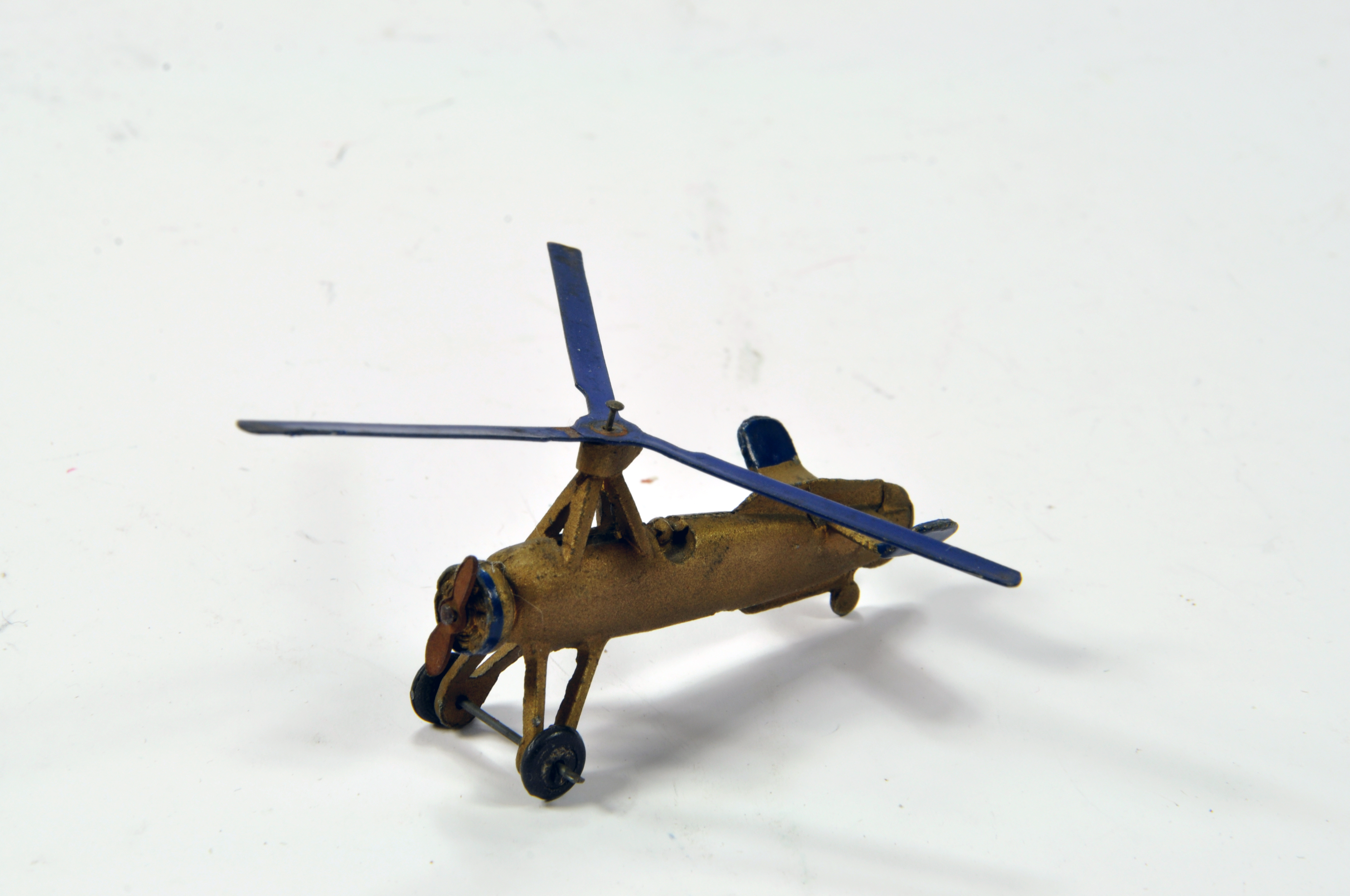 Lot 702 - Dinky No. 60f Pre-War Cierva Autogiro in gold with blue trim, blue rotor and steel twin blade