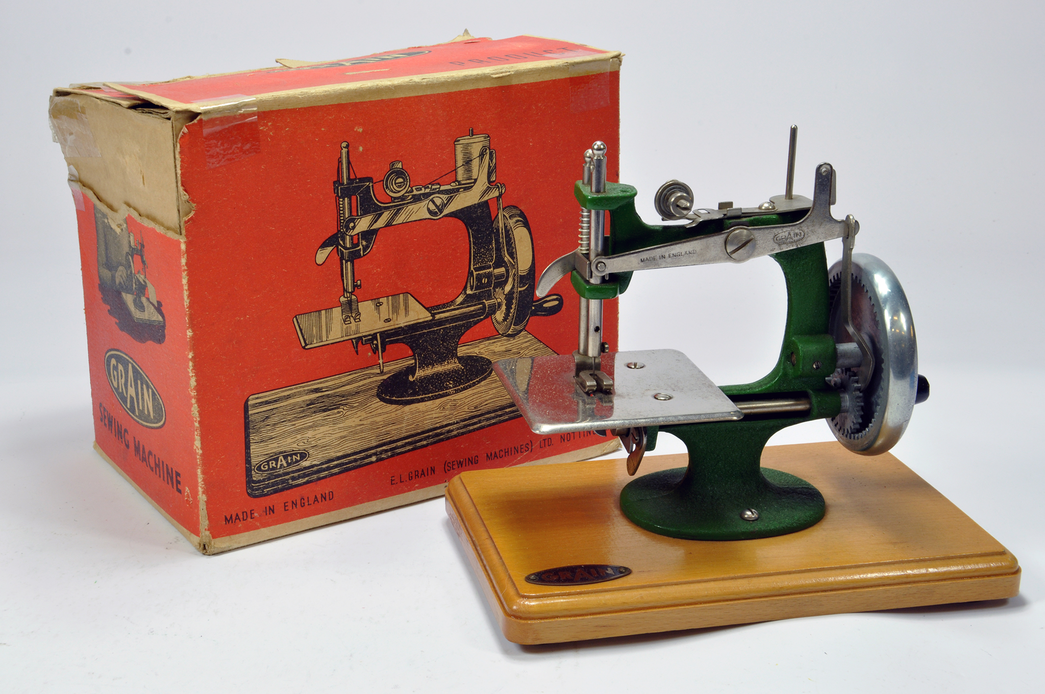 Lot 1181 - A Grain Metal Made Toy Sewing Machine. This well preserved issue appears complete and comes with