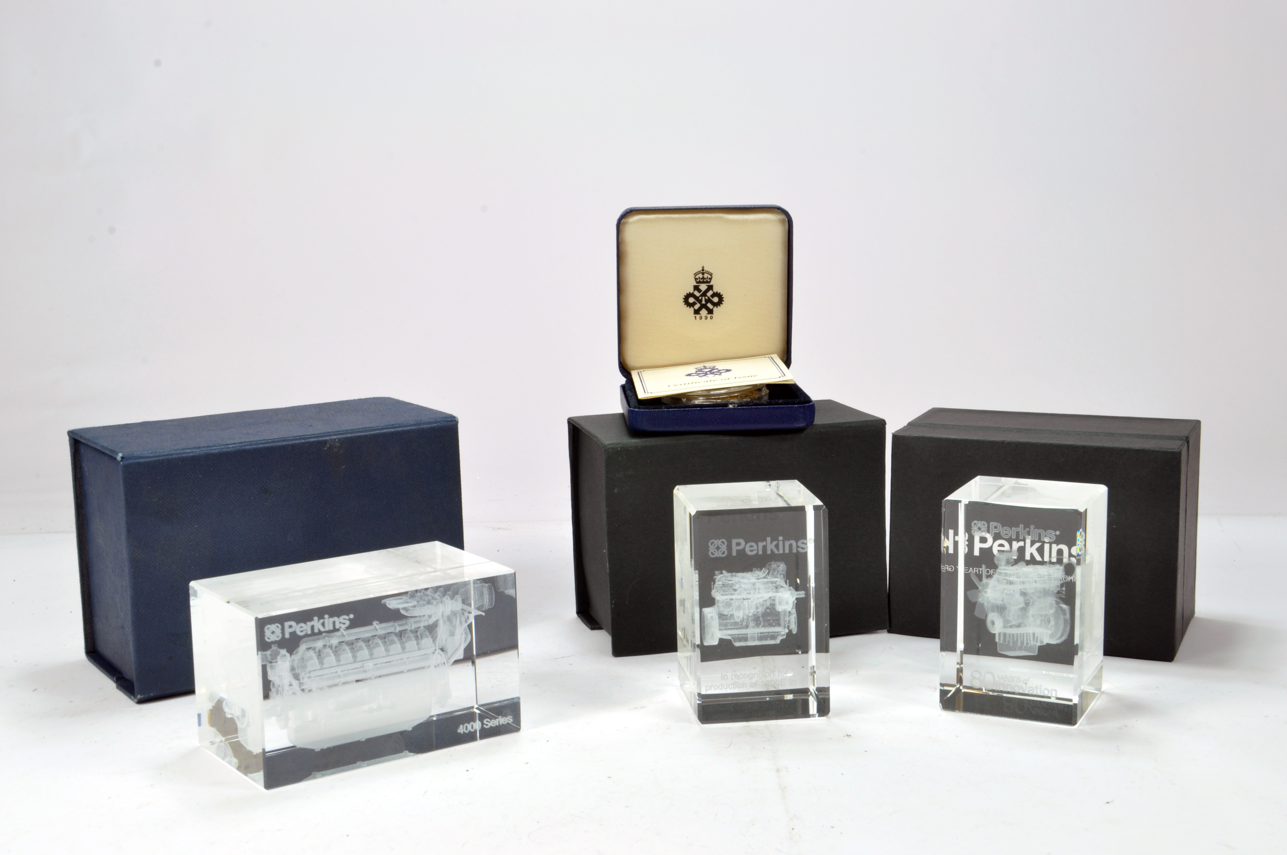 Lot 1137 - Interesting group of glass etched Perkins Engine Commemorative weights each with a different