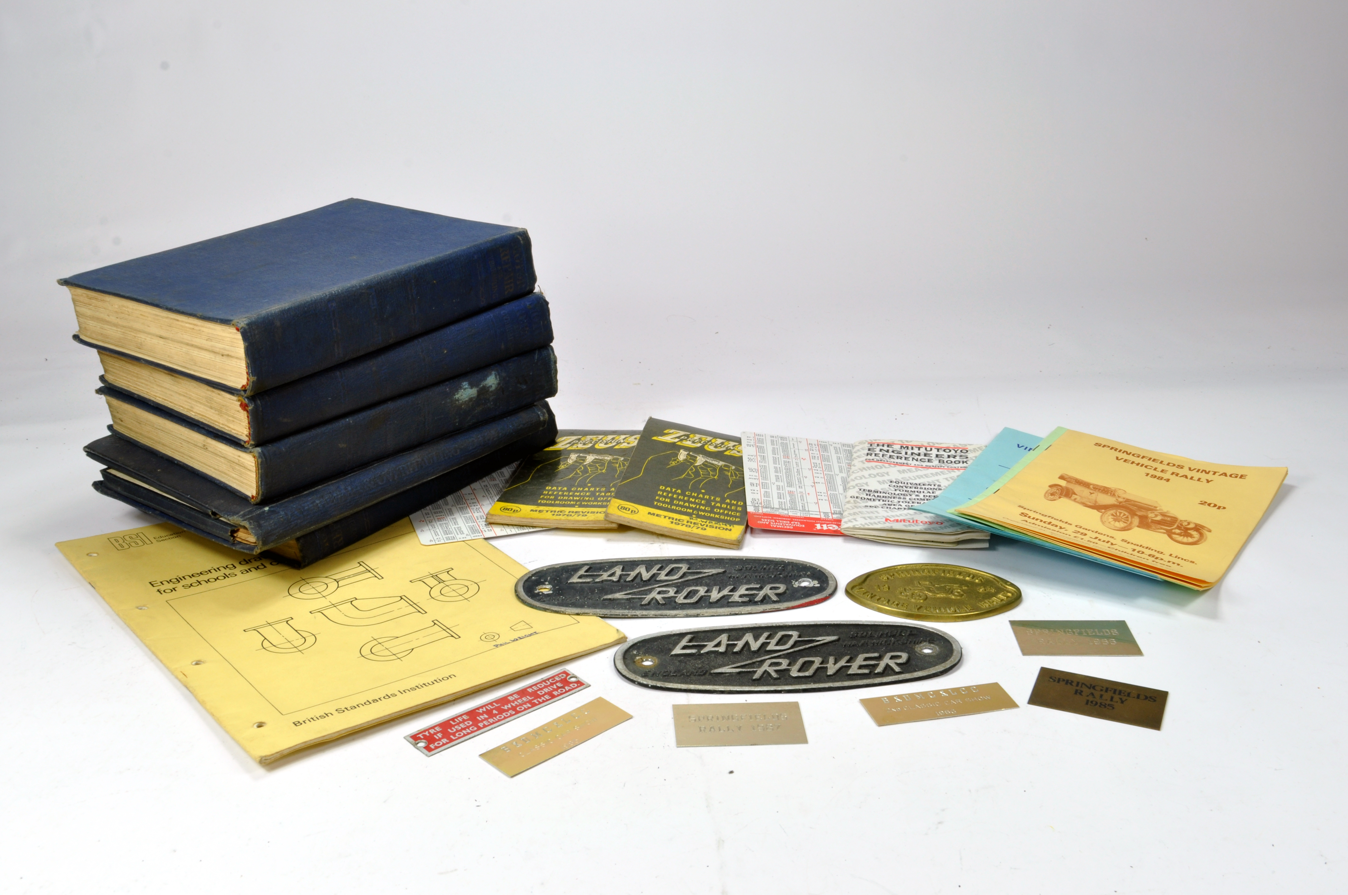 Lot 1143 - Original Early Land Rover Badges x 2 plus other items relating to technical measurement literature