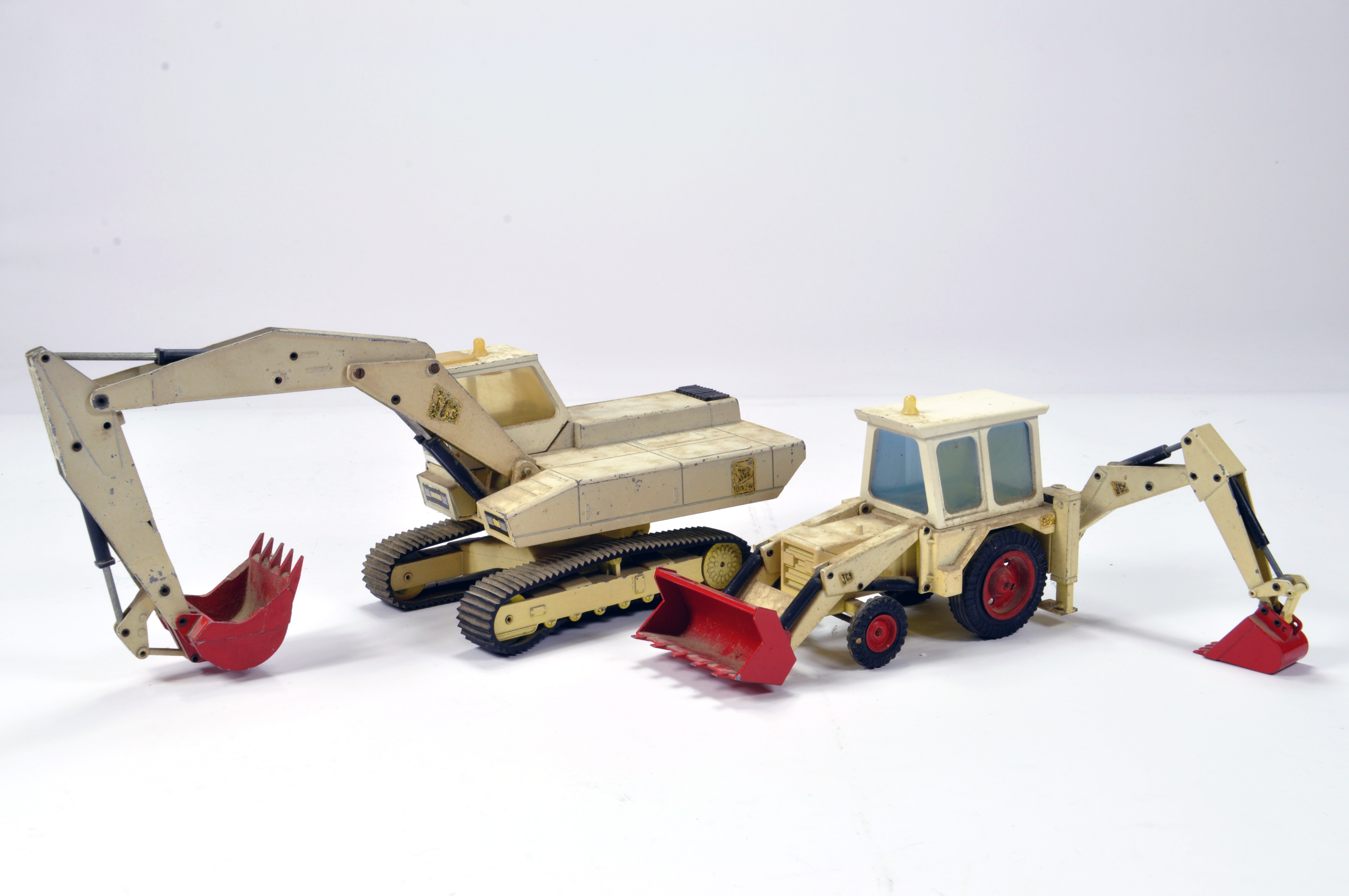 Duo of NZG construction diecast issues comprising Tracked Excavator and Backhoe Loader. F to G (