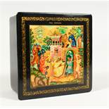 "A RUSSIAN BLACK PAPIER MACHE SQUARE BOX, ""Merrymaking"". 4ins x 4ins."