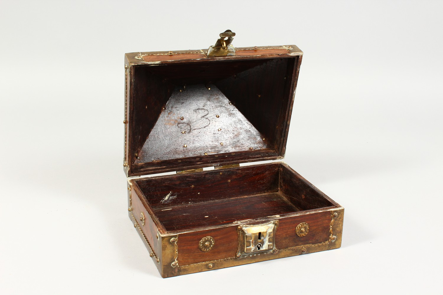 Lot 1356 - AN EASTERN BRASS BOUND WOODEN CASKET. 9ins wide.