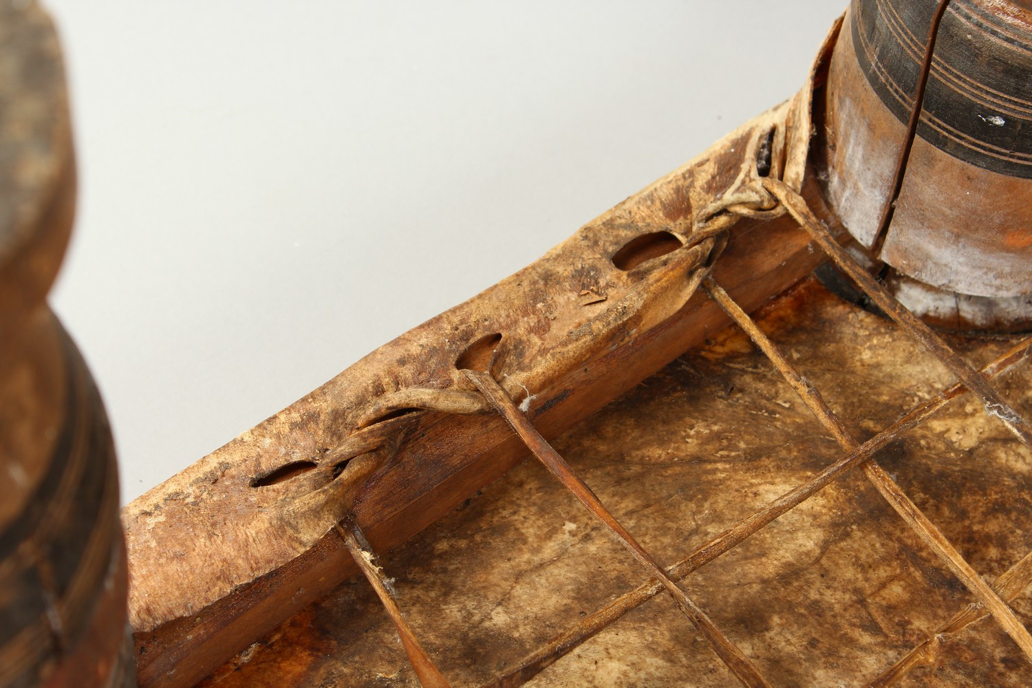 A NORTH AFRICAN PAINTED WOOD AND ANIMAL SKIN SQUARE SHAPED STOOL. 15ins wide x 11.5ins high. - Image 8 of 8