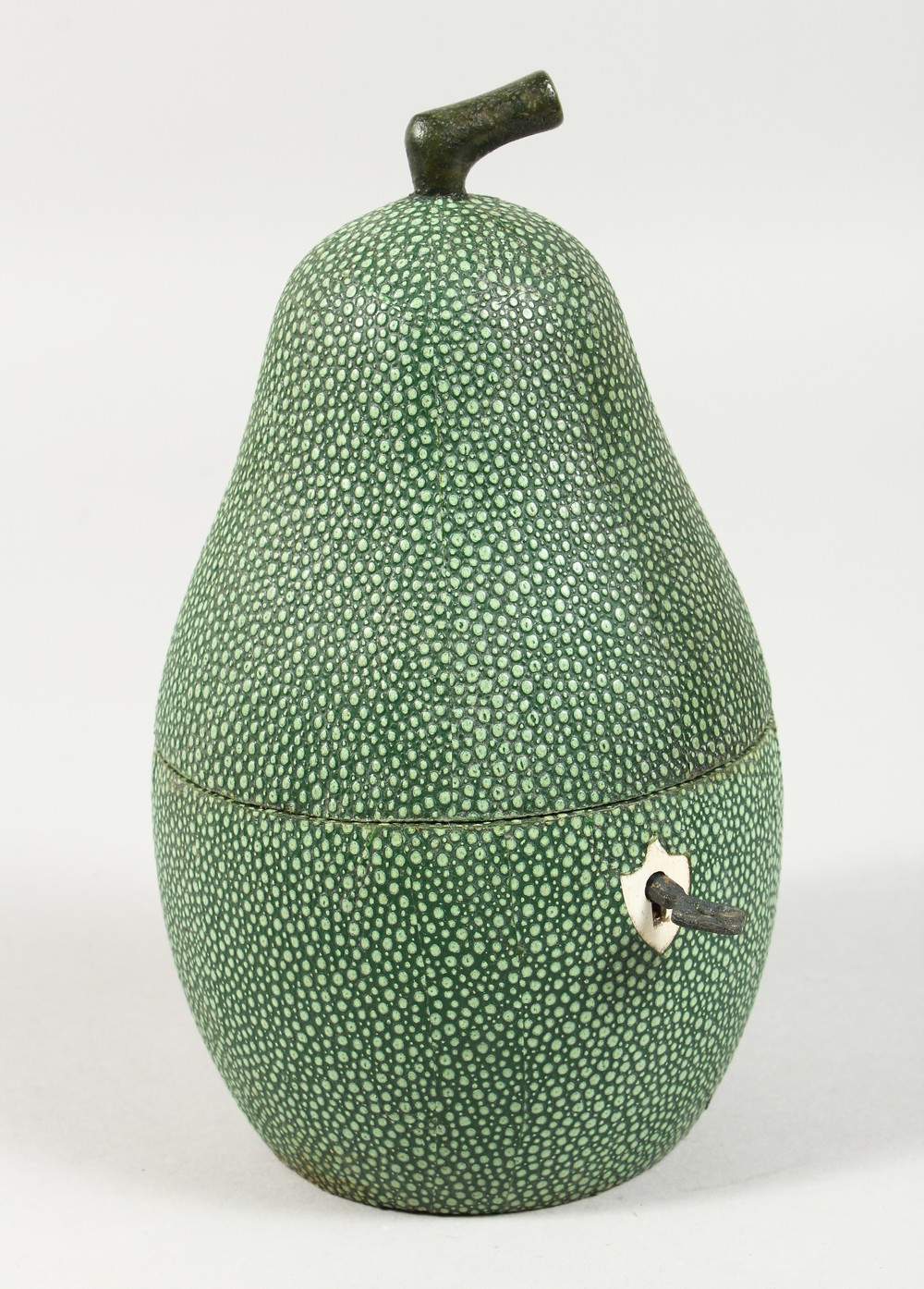 Lot 1373 - A SHAGREEN STYLE PEAR SHAPED TEA CADDY. 7ins high.