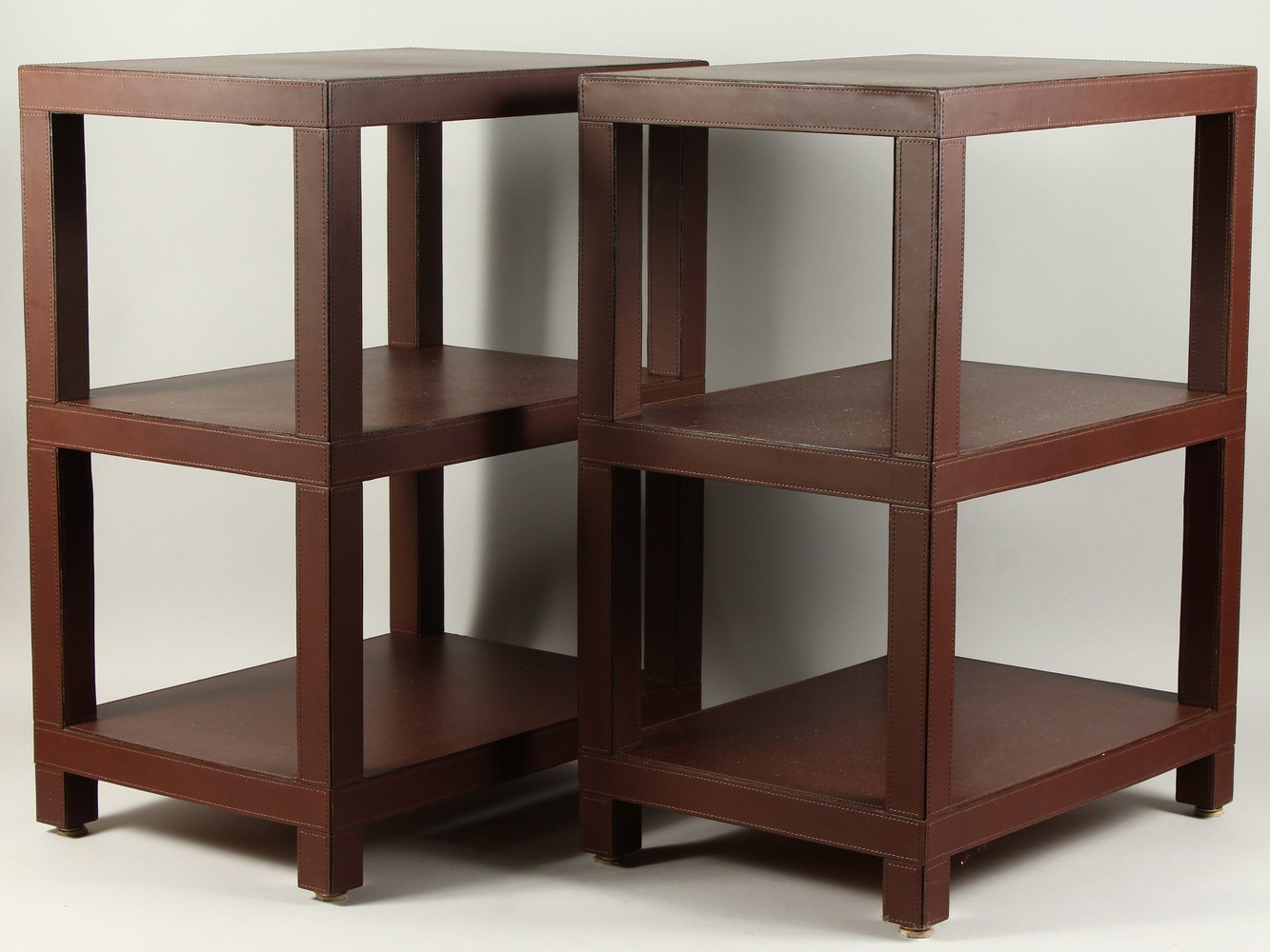 DOMINIC CHAMBON, A GOOD PAIR OF LEATHER COVERED THREE TIER OCCASIONAL TABLES. 48cms wide x 34cms - Image 2 of 6