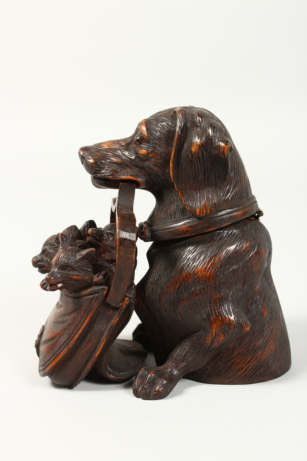 A BLACK FOREST STYLE CARVED WOOD INKWELL, modelled as a dog holding a bag of puppies in its mouth. - Image 2 of 4