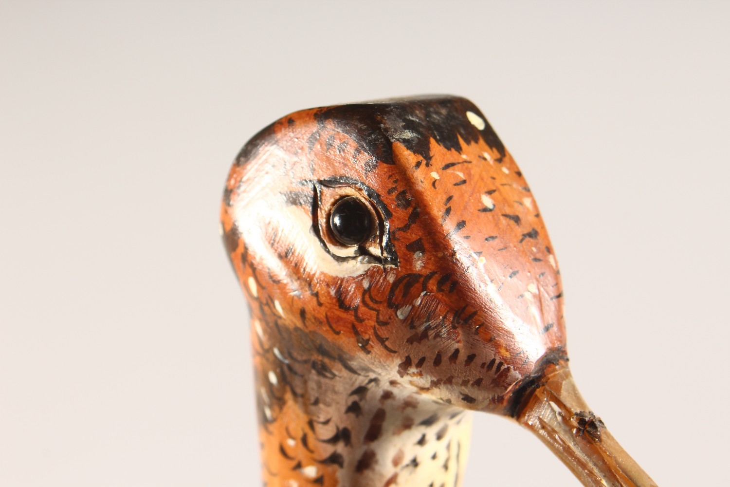 Lot 1520 - A WALKING STICK, with carved and painted pheasant head handle. 49ins long.