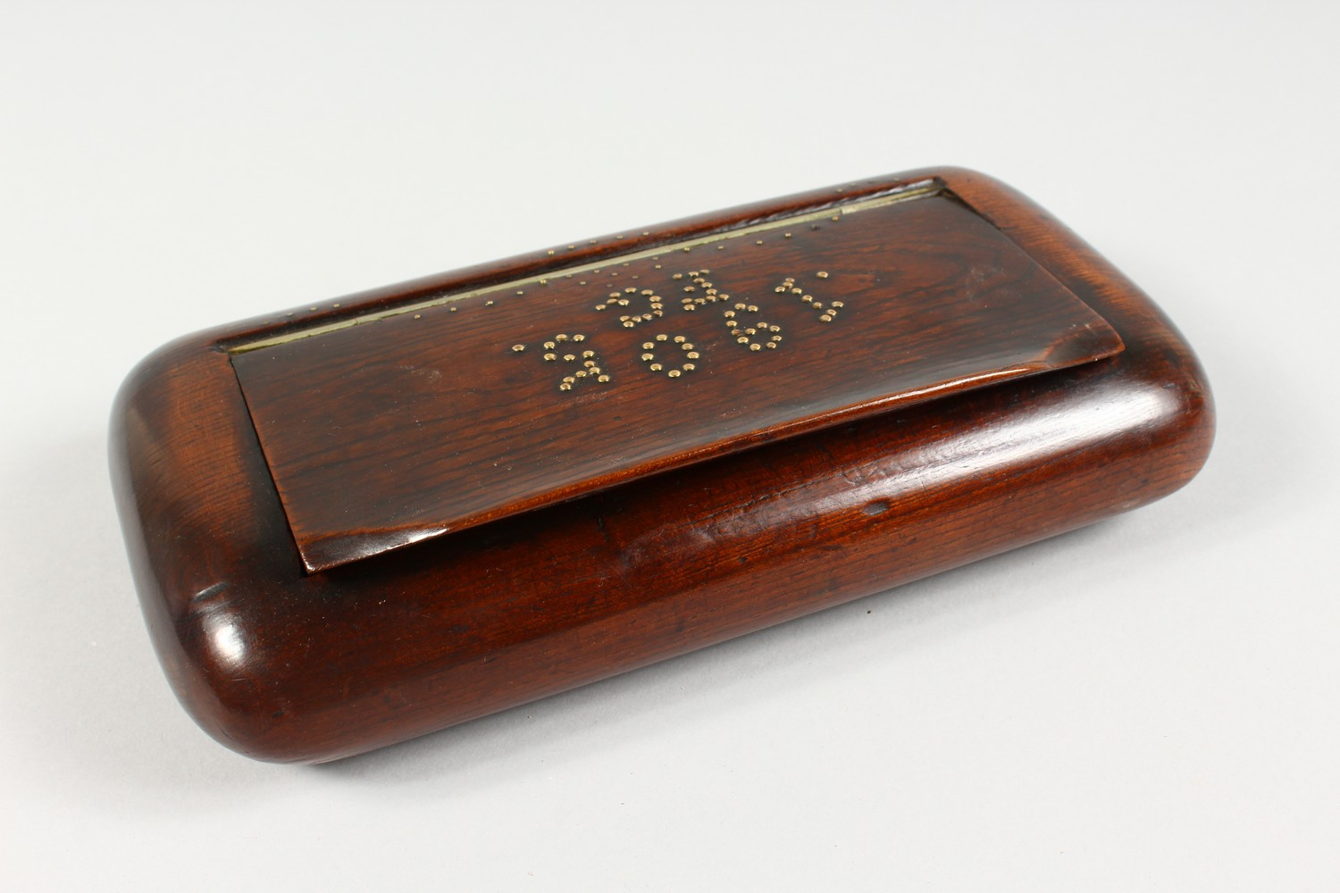 Lot 1421 - A LARGE WOODEN TABLE SNUFF BOX, studded brass inlaid date and initials 1905 FG. 10ins wide.