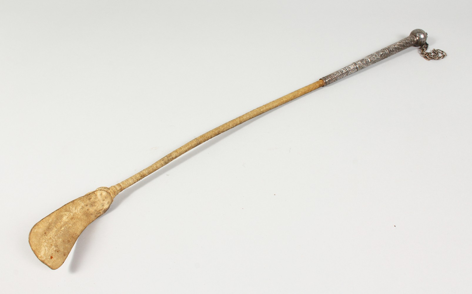 Lot 1424 - AN EASTERN SILVER HANDLED RIDING CROP. 25ins long.