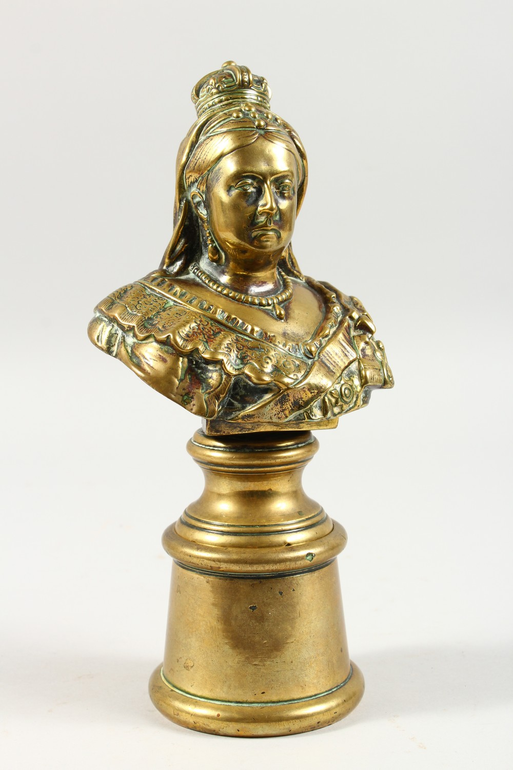 Lot 1427 - A BRONZE BUST OF QUEEN VICTORIA, to commemorate her Diamond Jubilee, on a pedestal. 10.5ins high.
