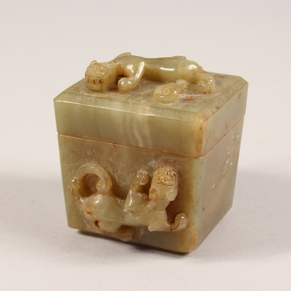 A CARVED SQUARE SHAPE BOX AND COVER. 3ins wide.