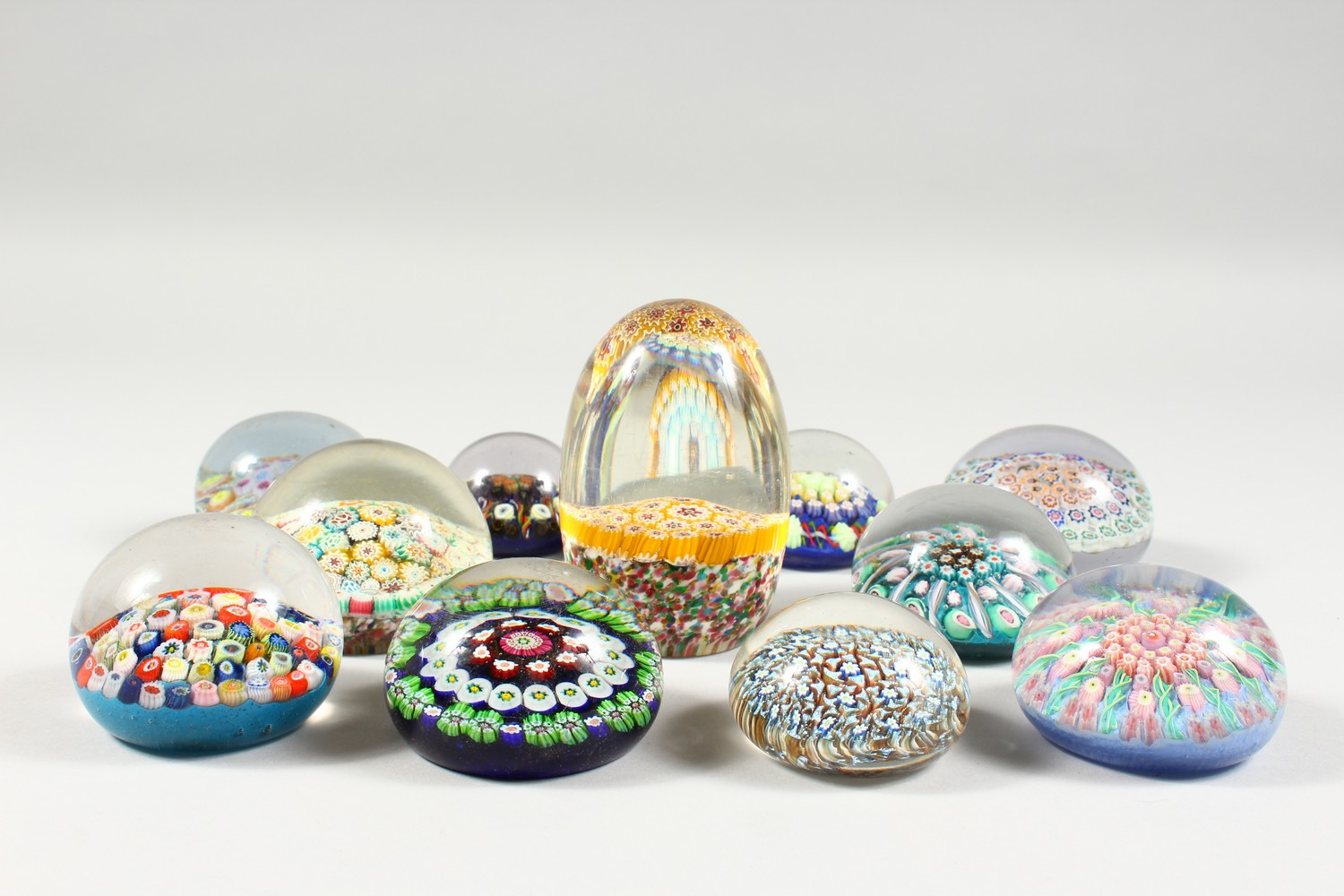 Lot 1059 - A COLLECTION OF THIRTEEN MILLEFIORI PAPERWEIGHTS. 3ins diameter and smaller.