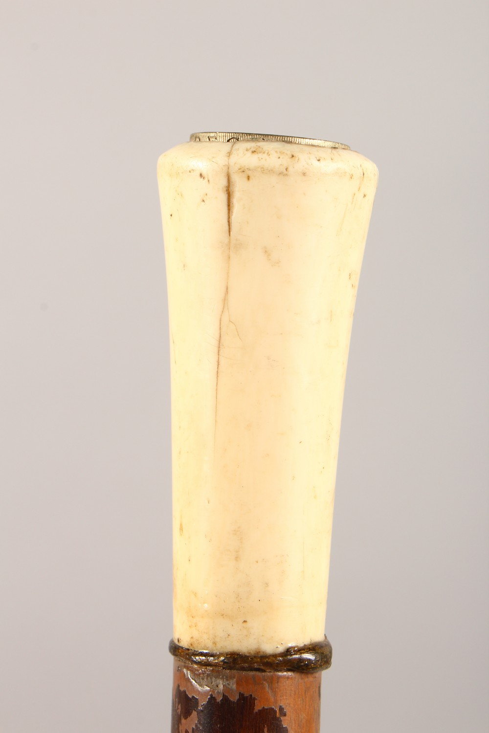 Lot 1526 - AN IVORY HANDLED WALKING STICK. 35ins long.
