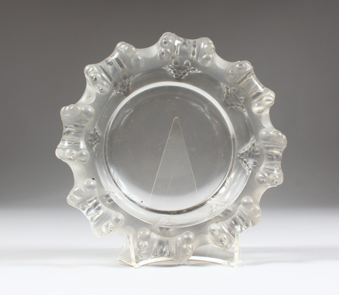 Lot 1050 - A LALIQUE LARGE ASHTRAY, with moulded rim. 7.5ins diameter.