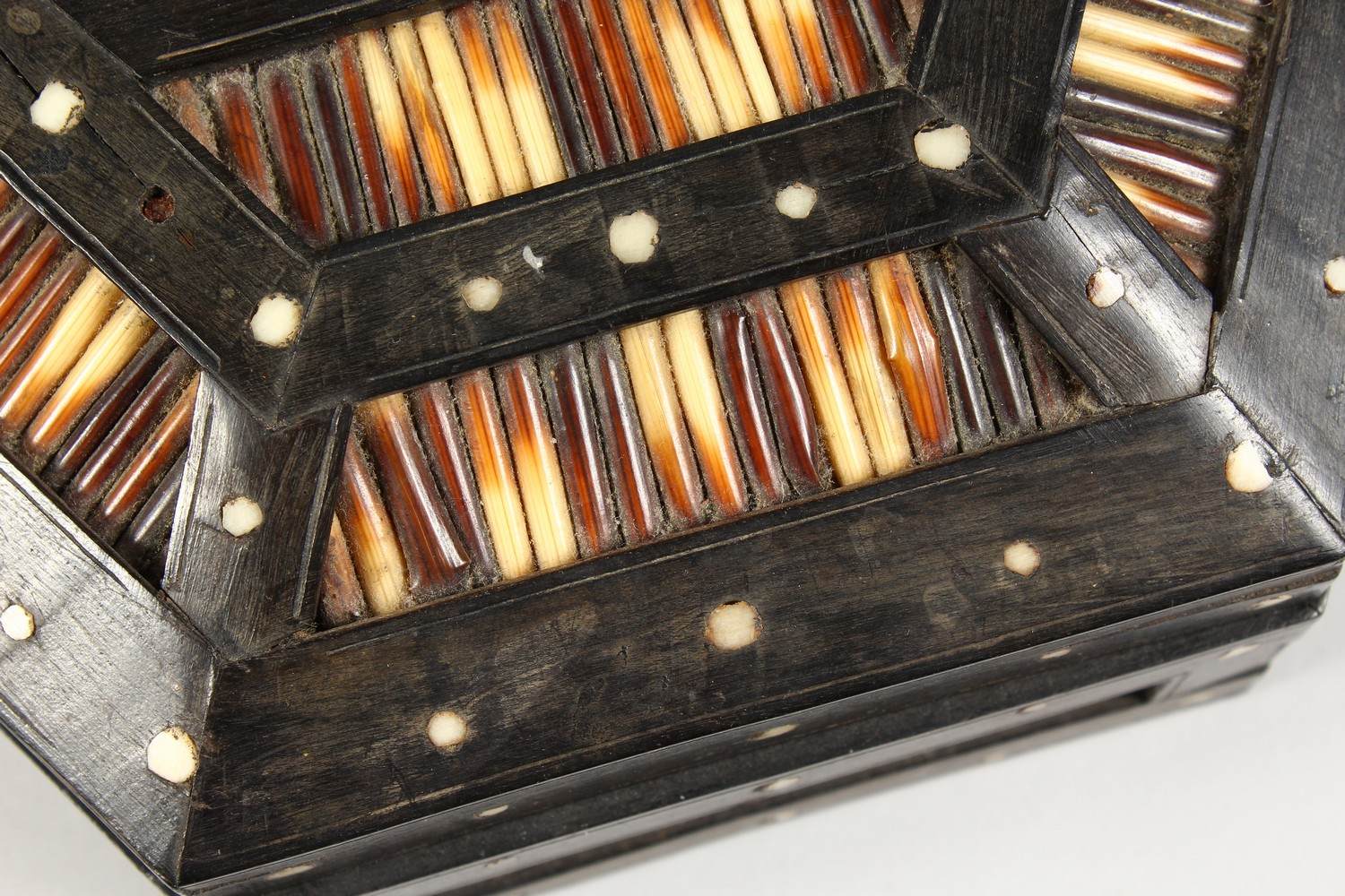 Lot 1483 - AN INDIAN ROSEWOOD AND PORCUPINE HEXAGONAL BOX AND COVER with carrying handle. 9ins.