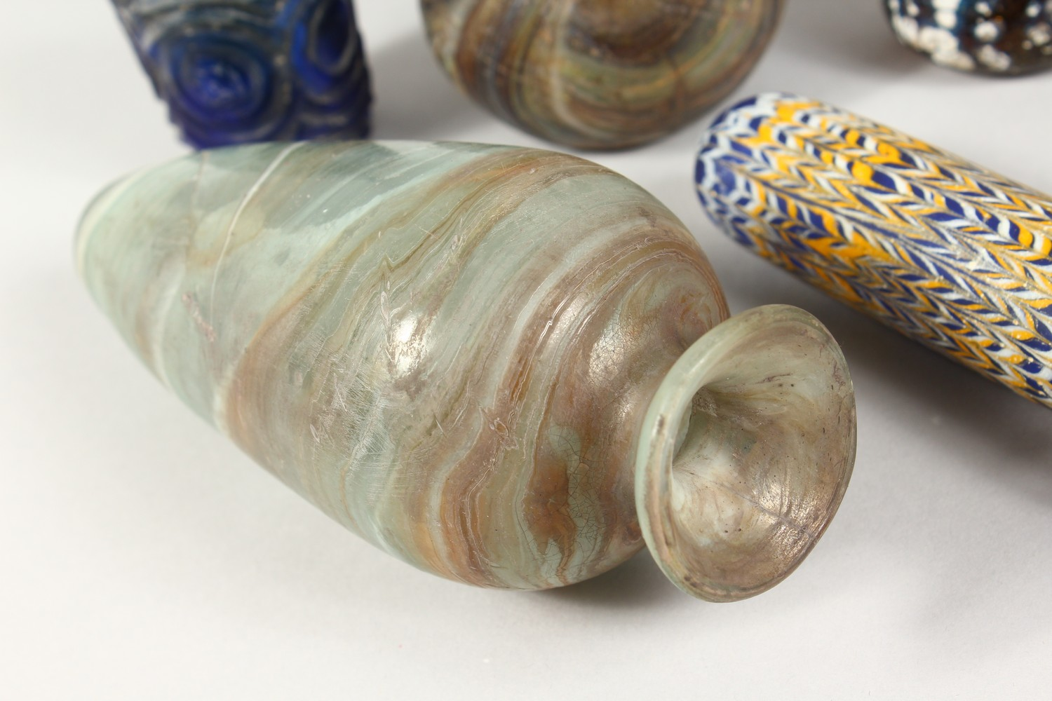 A GROUP OF THIRTEEN ROMAN GLASS BOTTLES AND JARS, including three tops in the form of heads (13). - Image 11 of 11