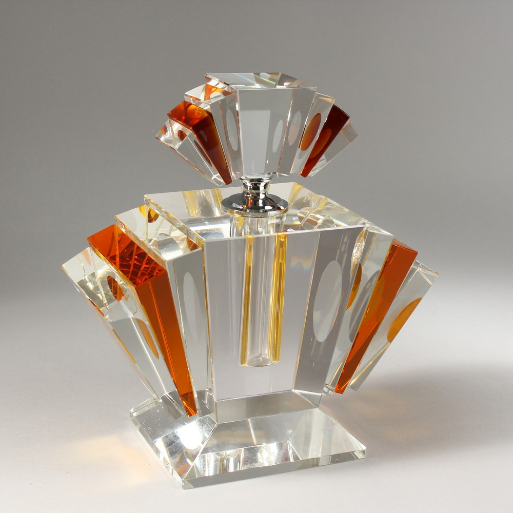 Lot 1054 - A LARGE CLEAR AND AMBER GLASS ART DECO STYLE SCENT BOTTLE. 9ins high.