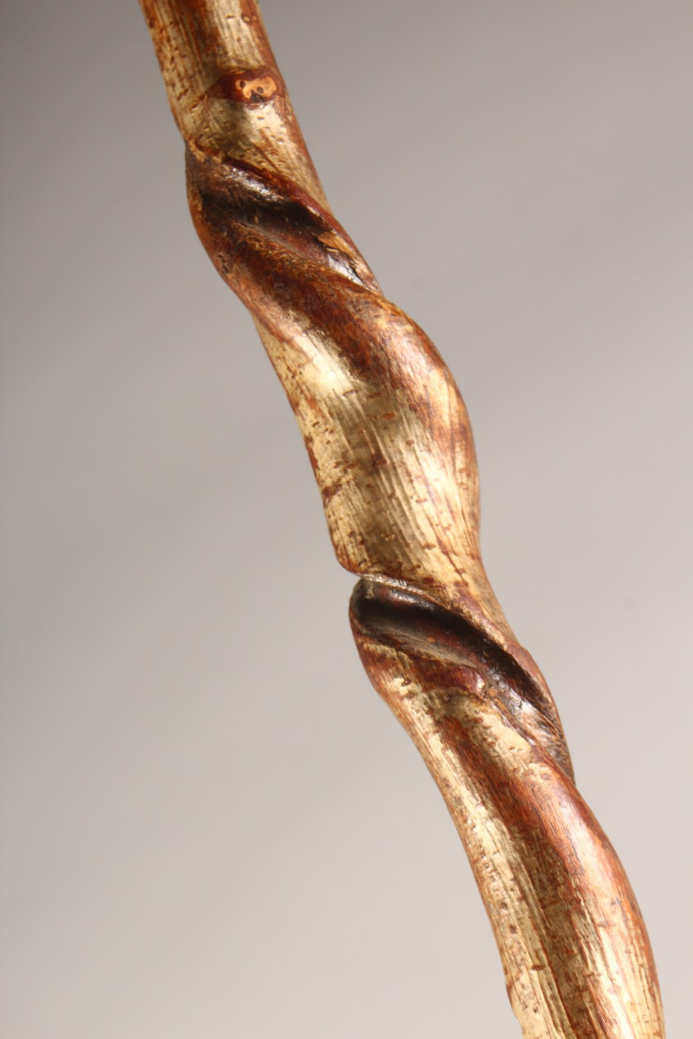 Lot 1519 - A HOOF HANDLED WALKING STICK, with twisted shaft. 48ins long.