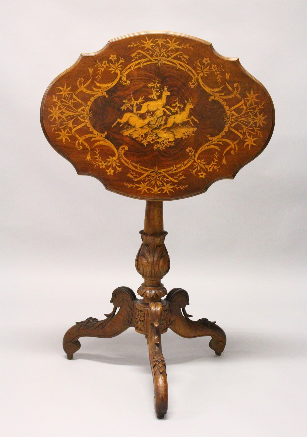 A LATE 19TH CENTURY BLACK FOREST INLAID TABLE. 2ft 1.5ins wide x 2ft 7ins high.