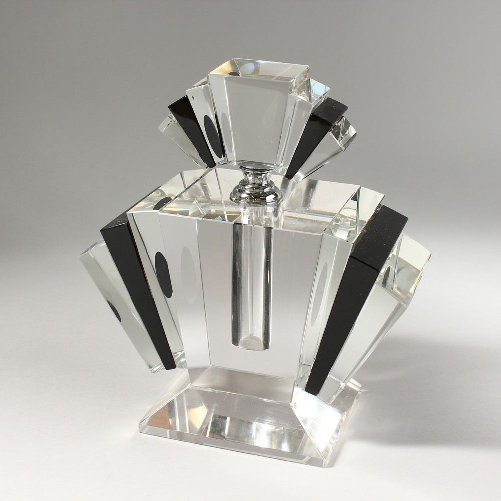 Lot 1052 - A LARGE CLEAR AND BLACK GLASS ART DECO STYLE SCENT BOTTLE. 9ins high.