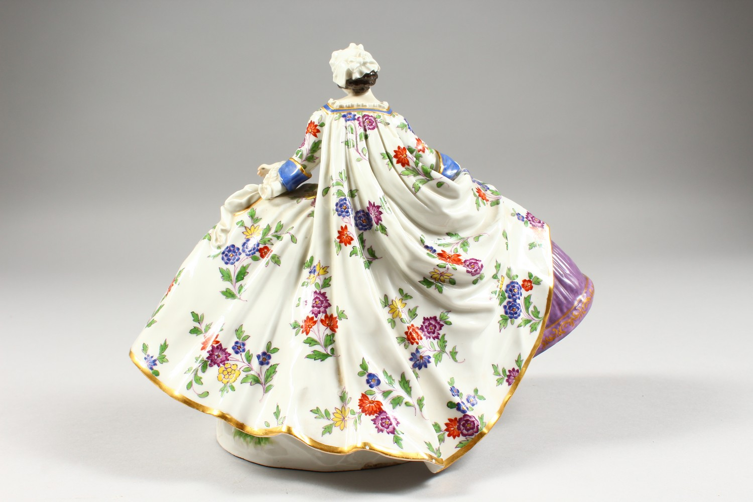 A GOOD LARGE MEISSEN FIGURE OF A LADY, wearing a floral skirt with purple underskirt, a folded fan - Image 4 of 7