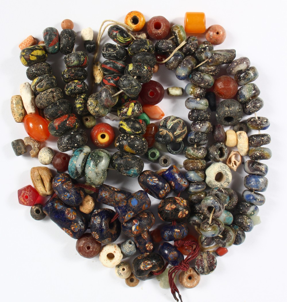 Lot 1299 - ROMAN GLASS BEADS, and other items (QTY).