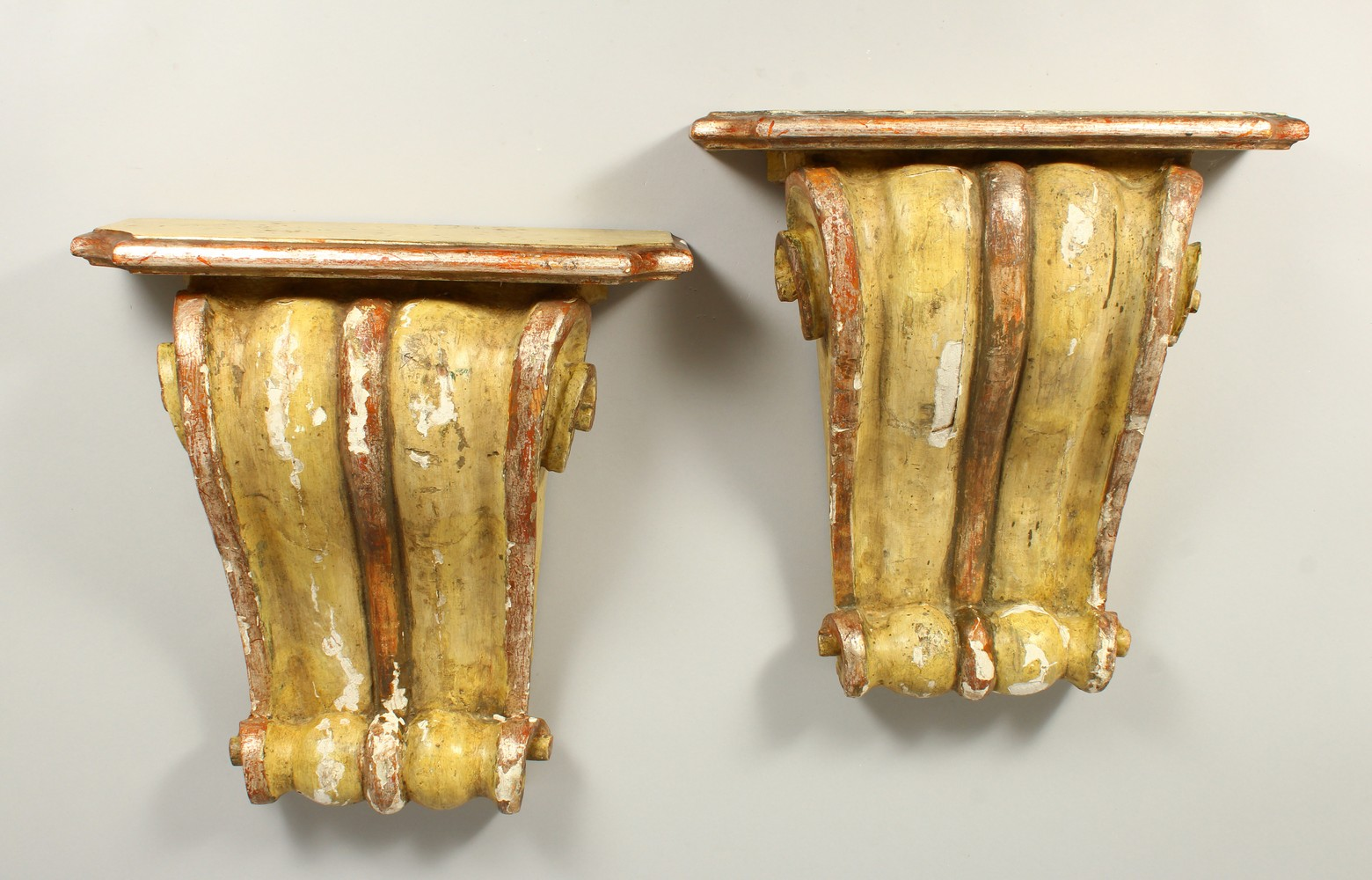 A PAIR OF 19TH/20TH CENTURY CARVED, GESSO AND PAINTED SCROLLING WALL BRACKETS. 41cms high x 40cms