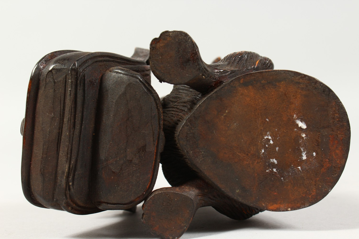A BLACK FOREST STYLE CARVED WOOD INKWELL, modelled as a dog holding a bag of puppies in its mouth. - Image 4 of 4