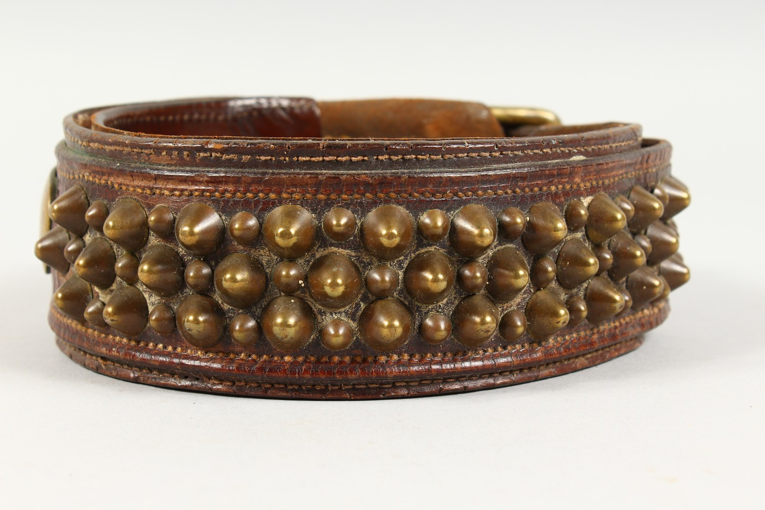 "Lot 1497 - AN EARLY 20TH CENTURY LEATHER AND BRASS STUDDED DOG COLLAR: TOM CUMLEY'S ""PEGGY"", 75 NIGHTINGALE"