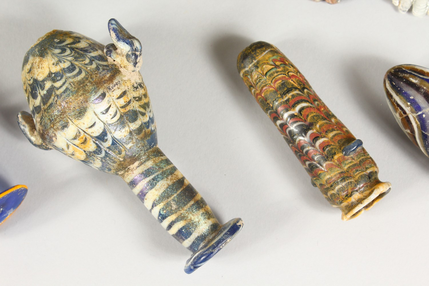 A GROUP OF THIRTEEN ROMAN GLASS BOTTLES AND JARS, including three tops in the form of heads (13). - Image 6 of 11