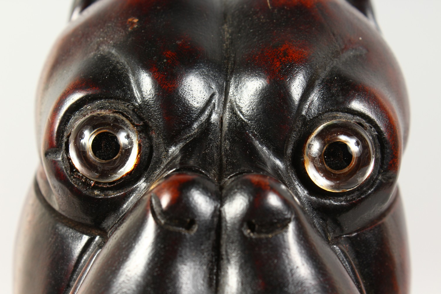 Lot 1385 - A BLACK FOREST STYLE CARVED WOOD TOBACCO JAR, modelled as a dogs head. 6ins high.