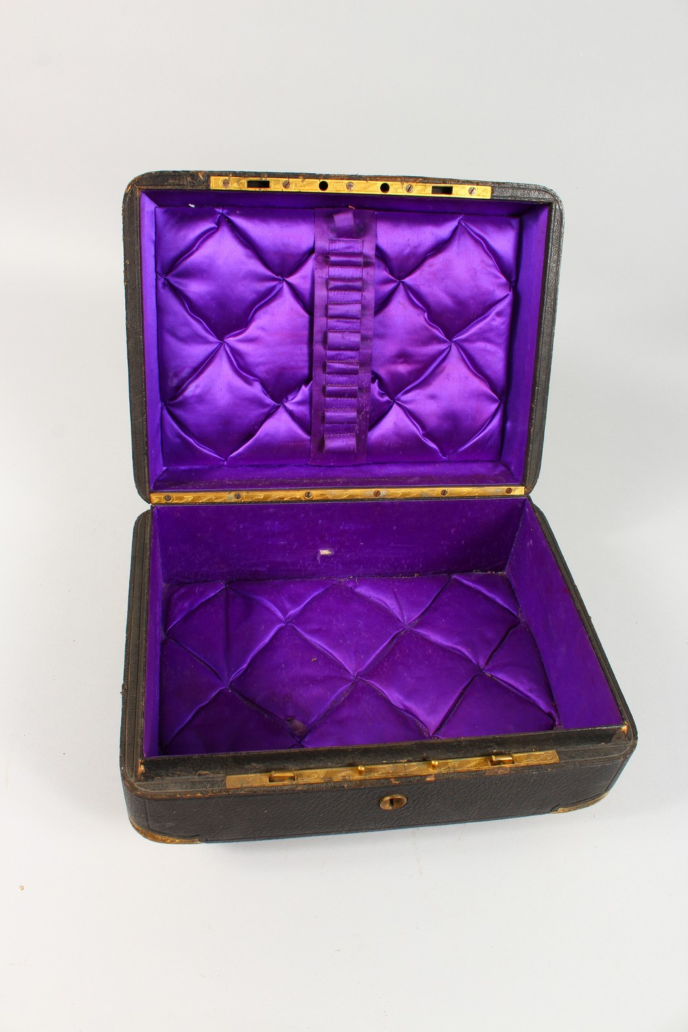 Lot 1416 - A GOOD VICTORIAN LEATHER SEWING BOX, with engraved brass corners, embossed brass floral mount and