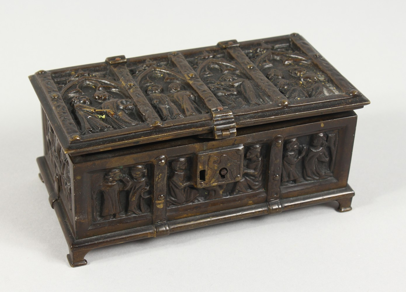 A MINIATURE BRONZE CHEST in the renaissance style. 5.5ins long.