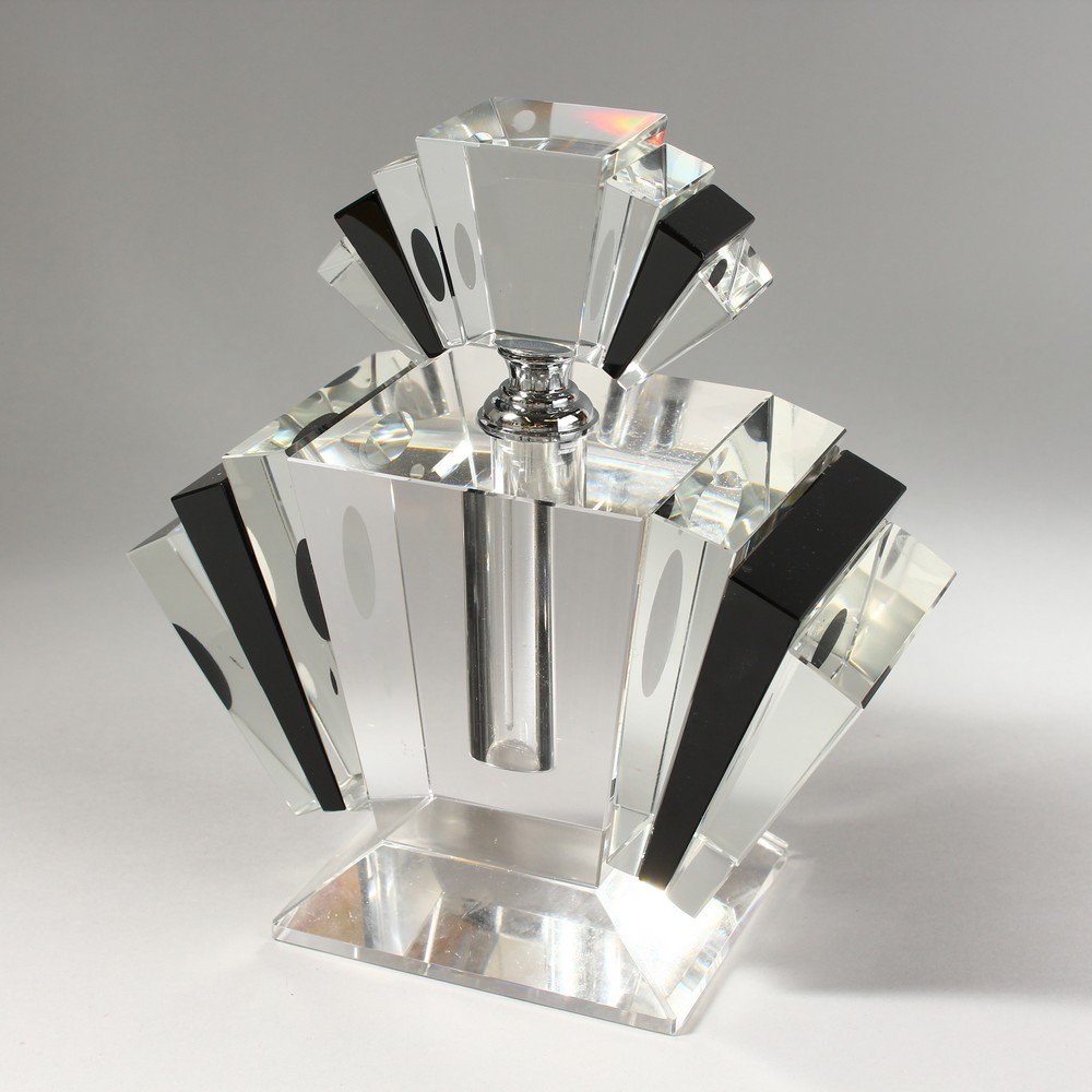 Lot 1051 - A LARGE CLEAR AND BLACK GLASS ART DECO STYLE SCENT BOTTLE. 9ins high.