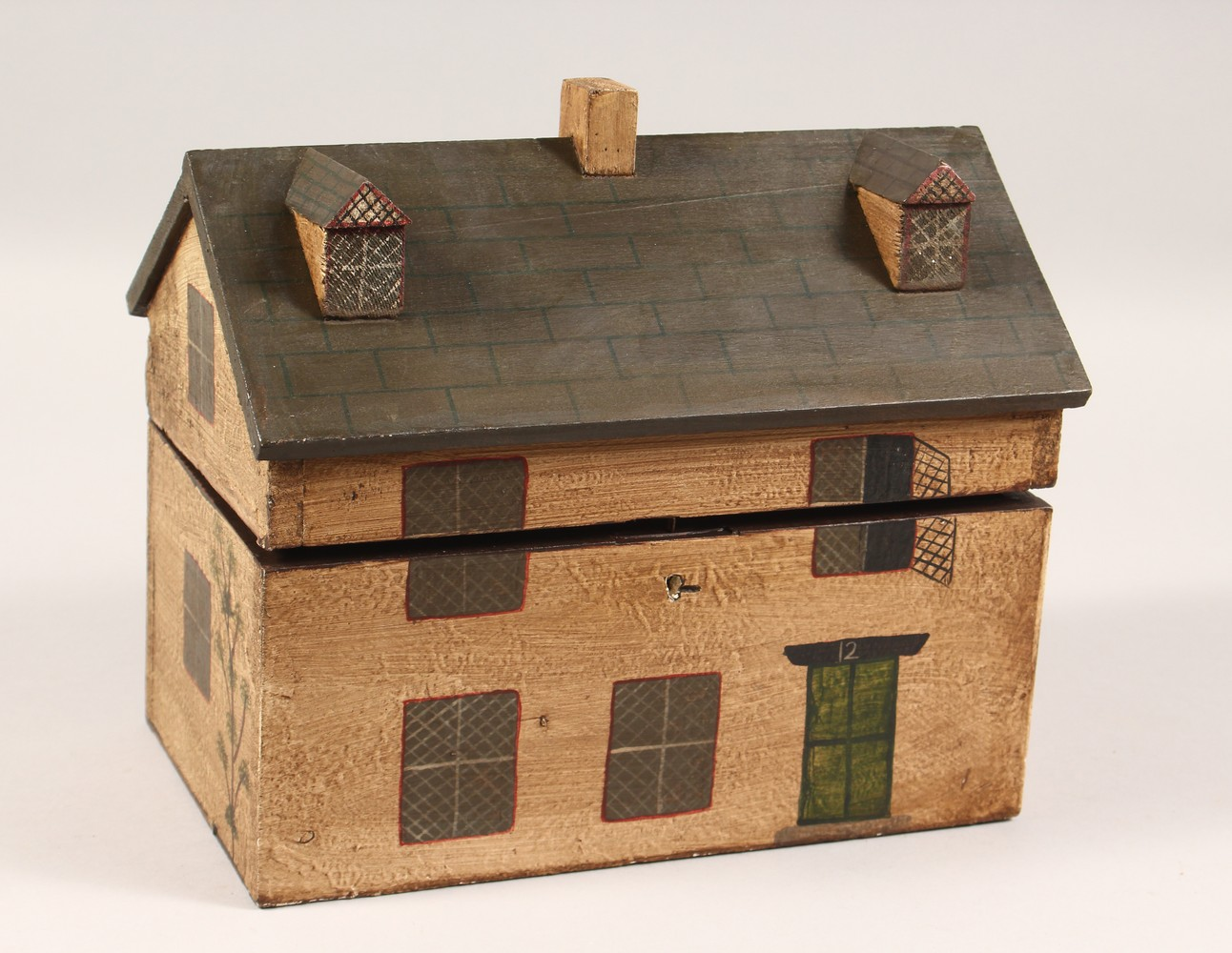 Lot 1428 - A PAINTED HOUSE STYLE TEA CADDY. 10ins long.