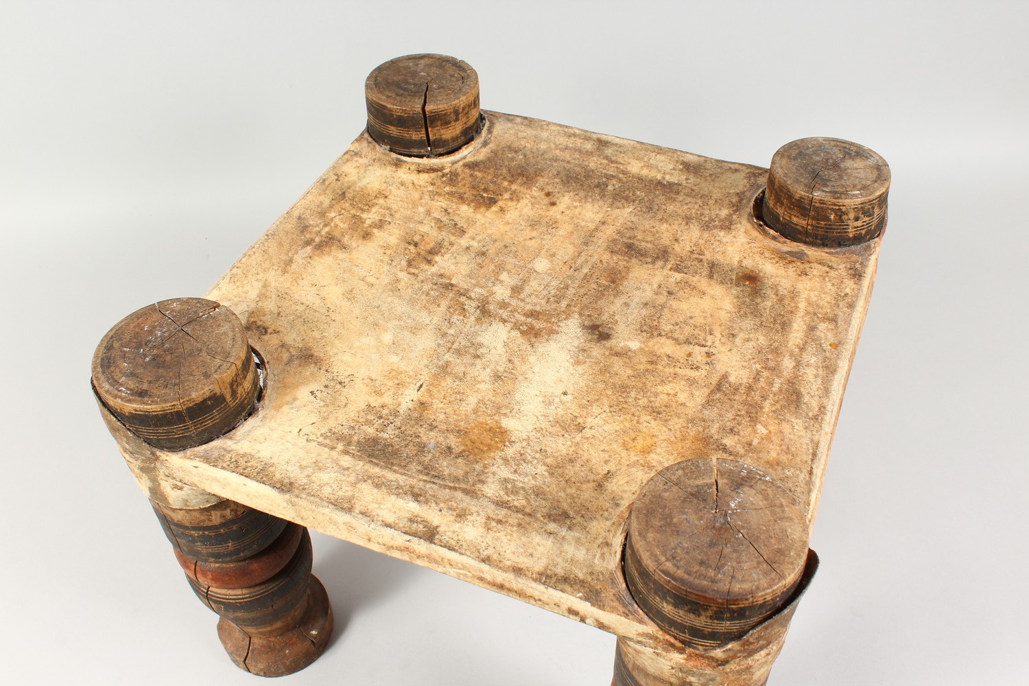 A NORTH AFRICAN PAINTED WOOD AND ANIMAL SKIN SQUARE SHAPED STOOL. 15ins wide x 11.5ins high. - Image 4 of 8