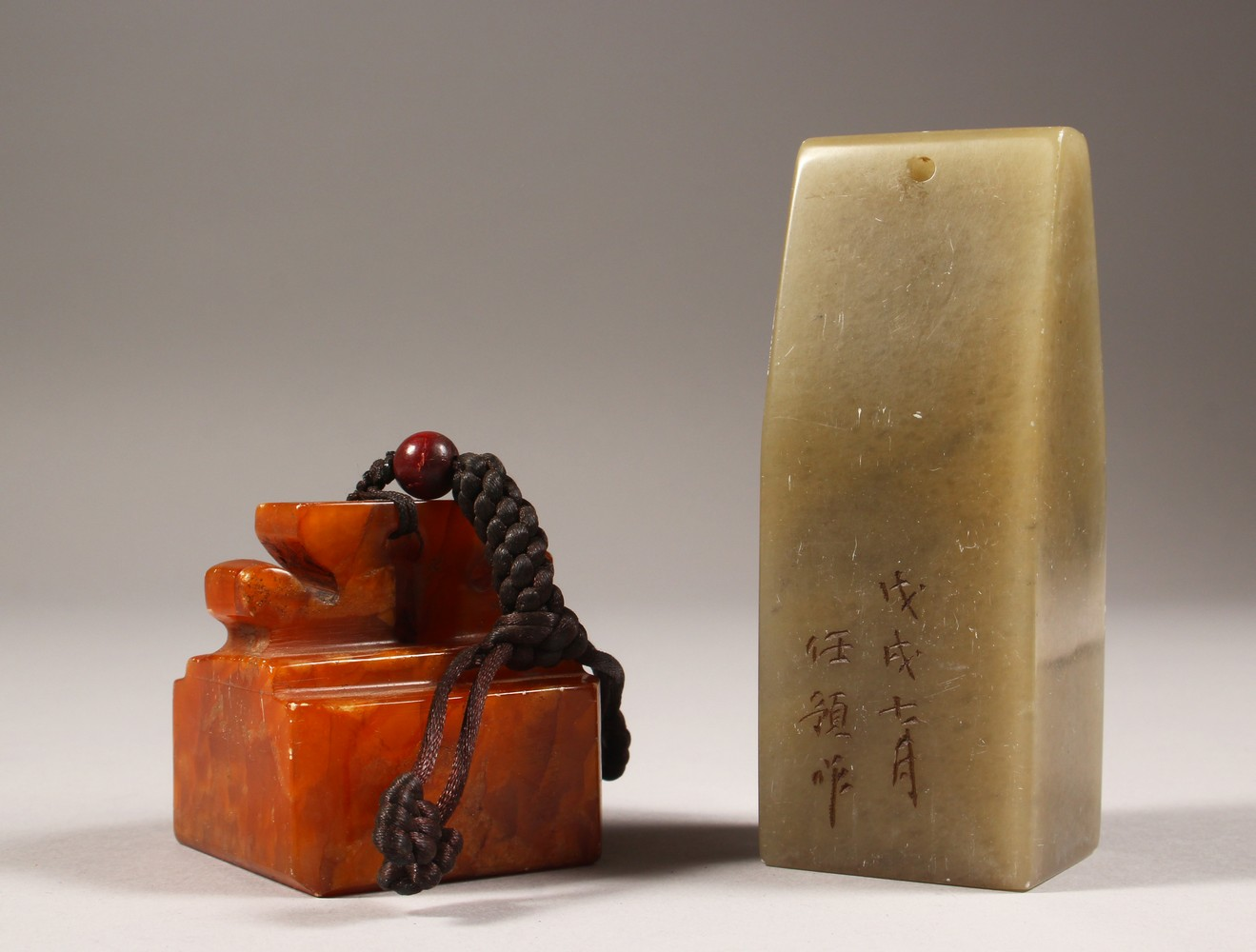 Lot 1239 - TWO HARDSTONE SEALS. 4ins high and 2ins wide.