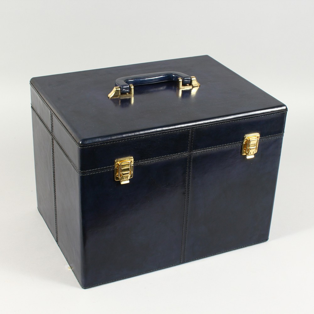 A BLUE LEATHER VANITY CASE.