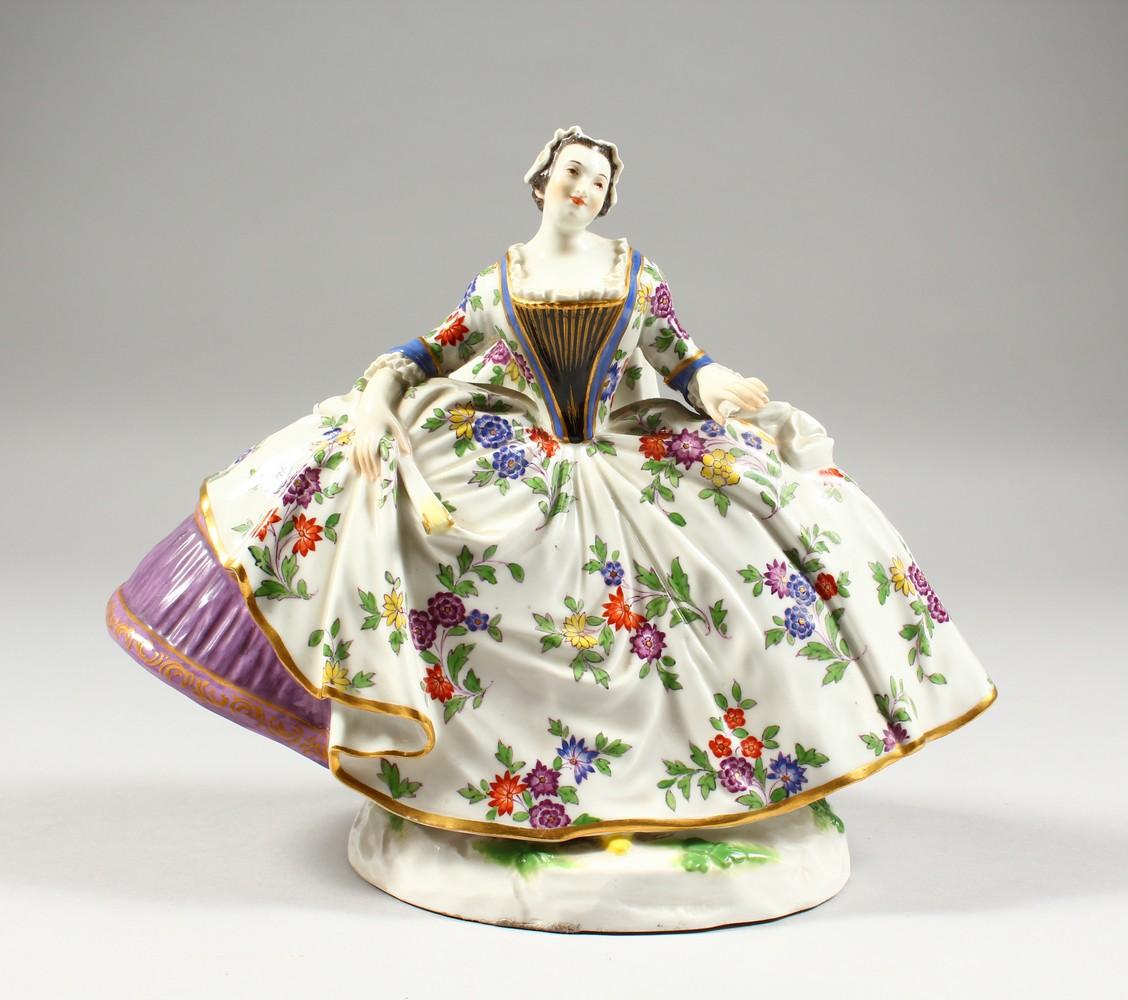 A GOOD LARGE MEISSEN FIGURE OF A LADY, wearing a floral skirt with purple underskirt, a folded fan