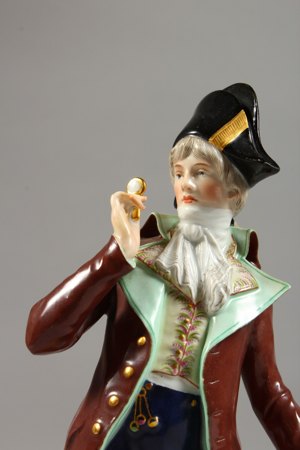 A MEISSEN FIGURE OF A DANDY, standing wearing a tailcoat, a stick in his left hand, a monocle in his - Image 2 of 6