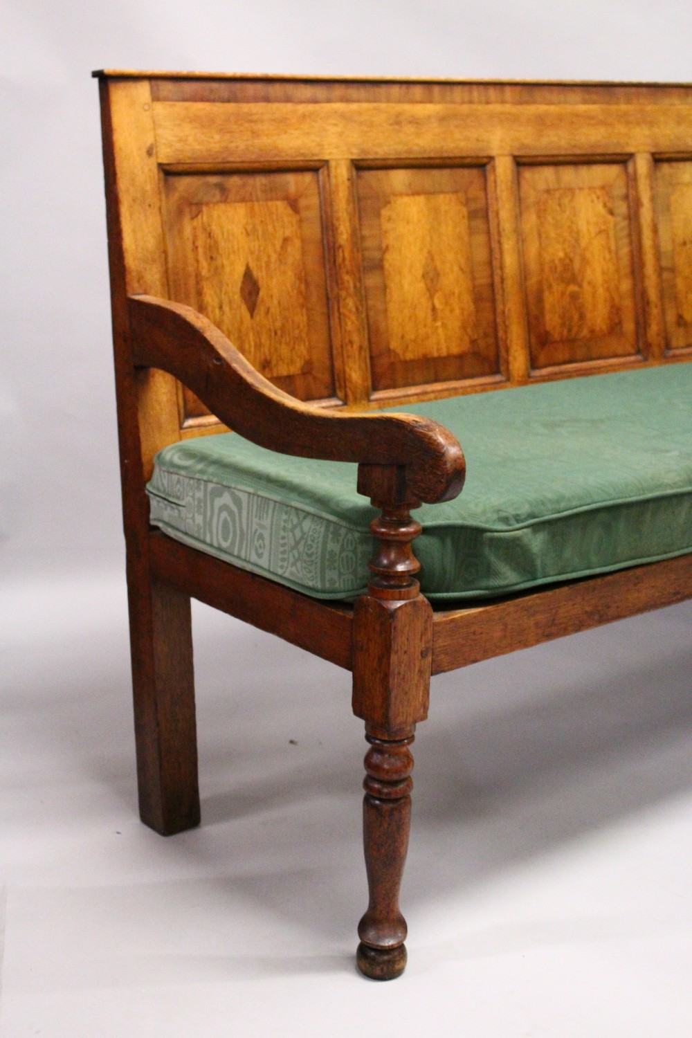 AN 18TH CENTURY OAK PANEL BACK SETTLE, with five mahogany banded panels, loose cushion, on turned - Image 2 of 6
