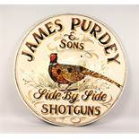 "A DECORATIVE CIRCULAR PAINTED PLYWOOD SIGN: ""JAMES PURDEY & SONS"". 35.5ins diameter."