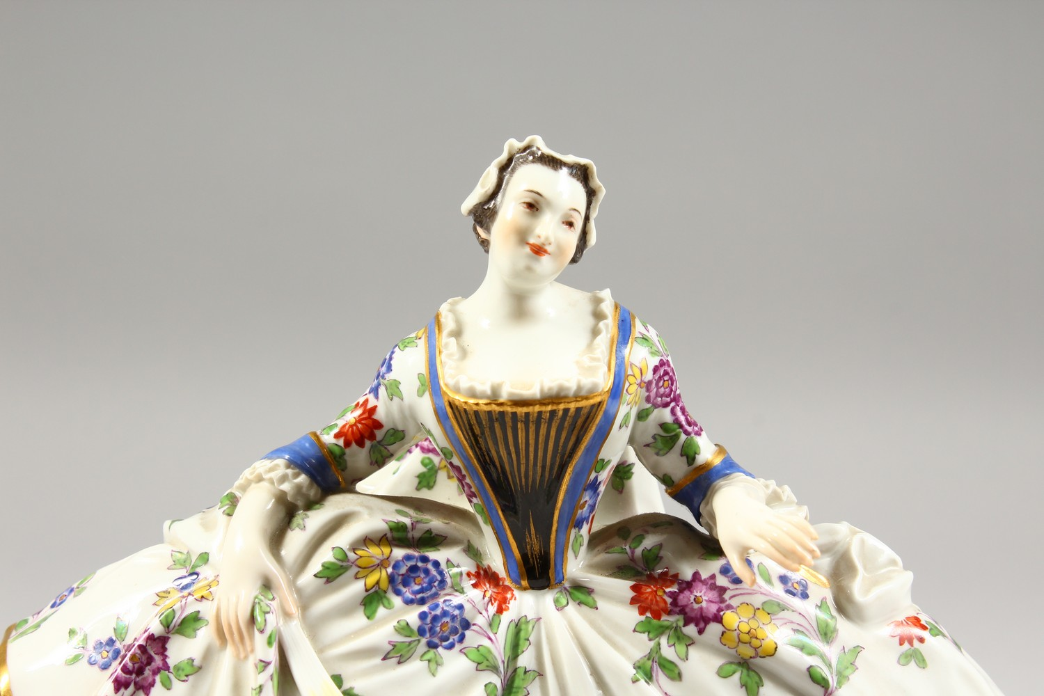A GOOD LARGE MEISSEN FIGURE OF A LADY, wearing a floral skirt with purple underskirt, a folded fan - Image 2 of 7