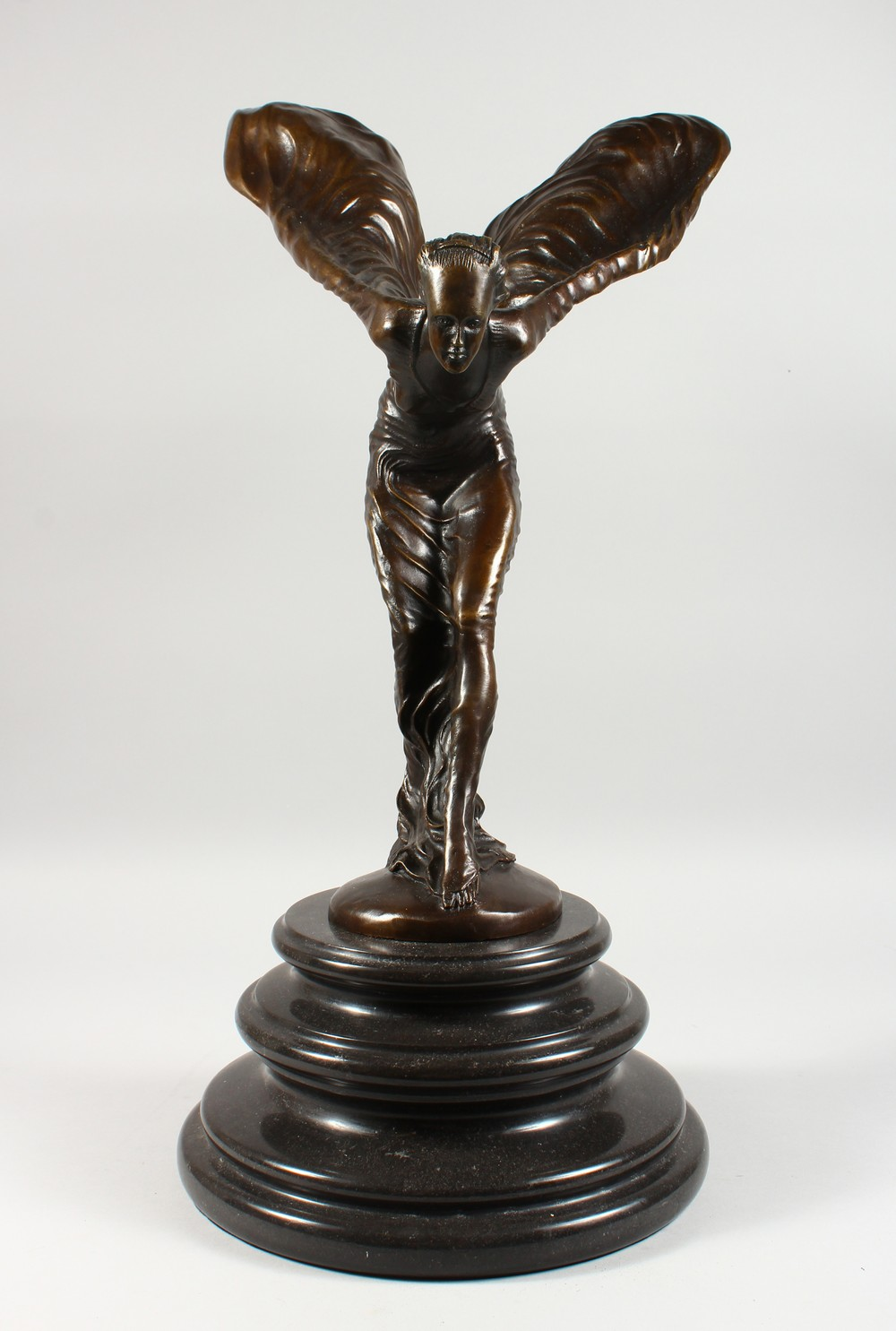"Lot 1328 - AFTER CHARLES SYKES ""THE SPIRIT OF ECSTASY"", a large reproduction bronze, on a circular marble base."