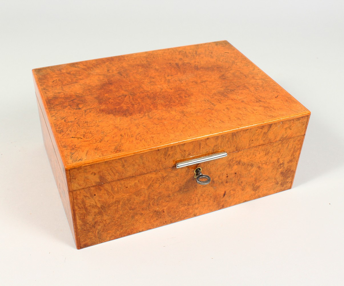 ALFRED DUNHILL, A GOOD BURR WOOD HUMIDOR. 10.25ins wide.