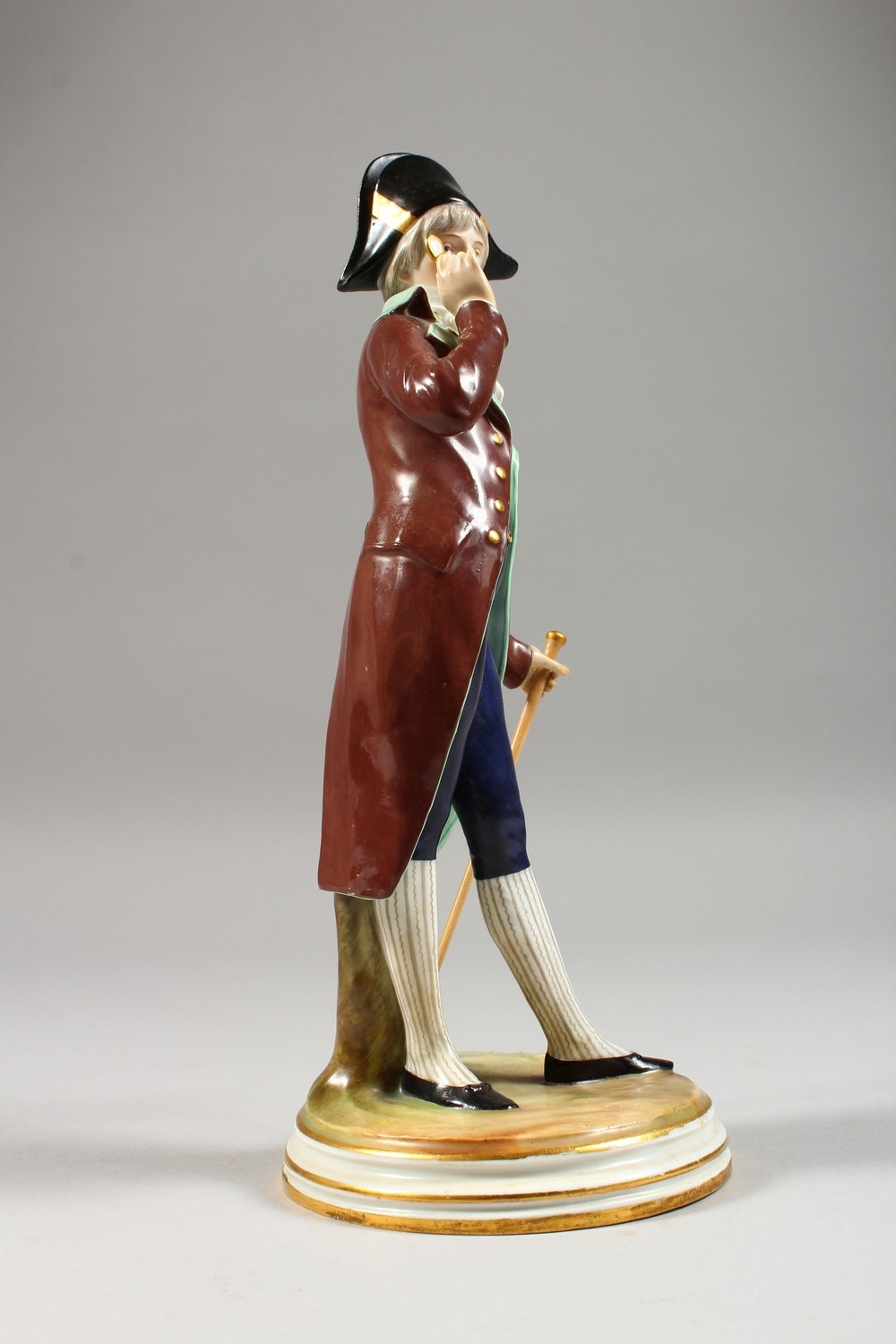 A MEISSEN FIGURE OF A DANDY, standing wearing a tailcoat, a stick in his left hand, a monocle in his - Image 5 of 6