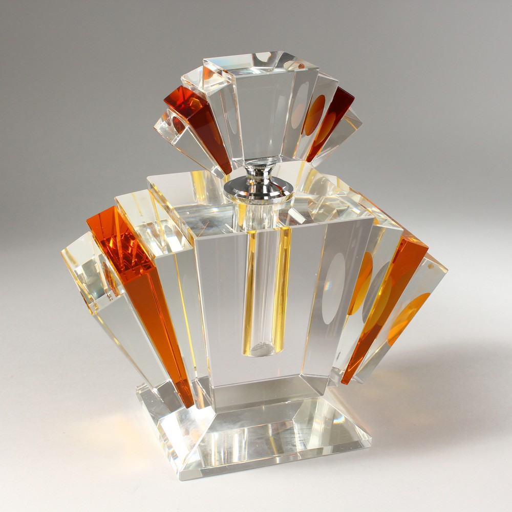 Lot 1053 - A LARGE CLEAR AND AMBER GLASS ART DECO STYLE SCENT BOTTLE. 9ins high.